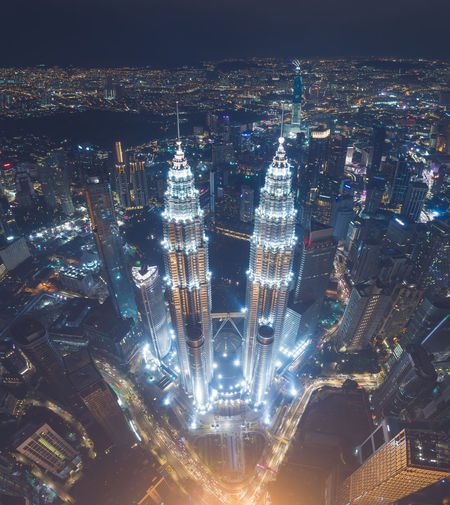 Aerial night of The Petronas Towers, also known as the Petronas Twin Towers are twin skyscrapers in Kuala Lumpur, Malaysia. According to the Council on Tall Buildings and Urban Habitat (CTBUH)'s official definition and ranking, they were the tallest buildings in the world from 1998 to 2004 and remain the tallest twin towers in the world. KLCC Twin Towers Suria KLCC View Aerial Aerial View Architecture Building Exterior Built Structure City City Life Cityscape Illuminated Lanscape Malaysia Malaysia, Kuala, Lumpur, Klcc, Twin, Petronas, City, Skyline, Tower, Urban, Modern, Architecture, Asia, Landmark, Skyscraper, Building, Kl, Sky, View, Park, Business, Night, Cityscape, Suria, Landscape Modern Night No People Outdoors Petronas Skyscraper Travel Destinations