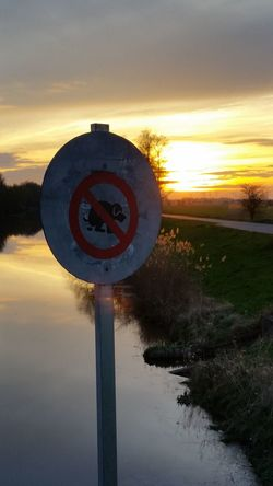 Sunset Sunlight Reflection No People Beauty In Nature Vareler Schleuse Vareler Hafen Outdoors Water Nature Sign