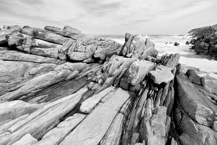Panoramic view of rock formation on beach against sky