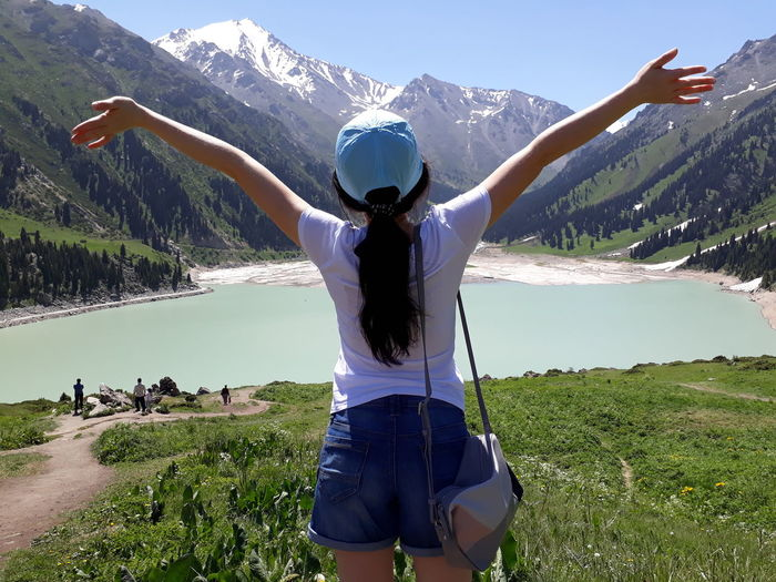 Mountain Limb Human Arm Arms Raised One Woman Only Only Women Adult Nature People Water Arms Outstretched Adults Only Grass Human Body Part One Person Vacations Mountain Range Casual Clothing Young Adult Beauty In Nature Go Higher
