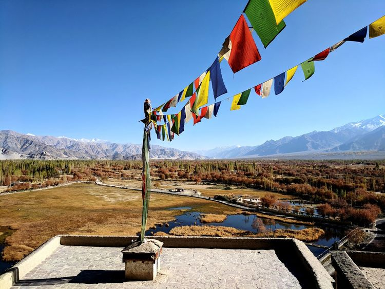 Outdoors Flag Day Blue No People Clear Sky Sky Prayer Flags  Buddhism Mountains Poplars Perspectives On Nature Be. Ready.