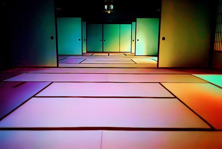 Illuminated Doors In Abstract Room