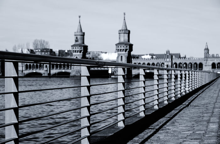 the fence Architecture Berlin Building Exterior Built Structure City Clear Sky Diagonal Fence Geländer Licht Und Schatten Light And Shadow Monochromatic Monochrome No People Oberbaumbrücke Outdoors Railing Railing Sky Travel Destinations Water