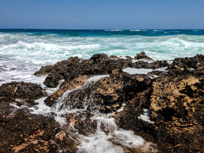 Sea Water Motion Sky Beauty In Nature Scenics - Nature Horizon Rock Horizon Over Water Land Wave Beach Rock - Object Solid Sport Nature Aquatic Sport No People Day Outdoors Power In Nature Flowing Water Breaking