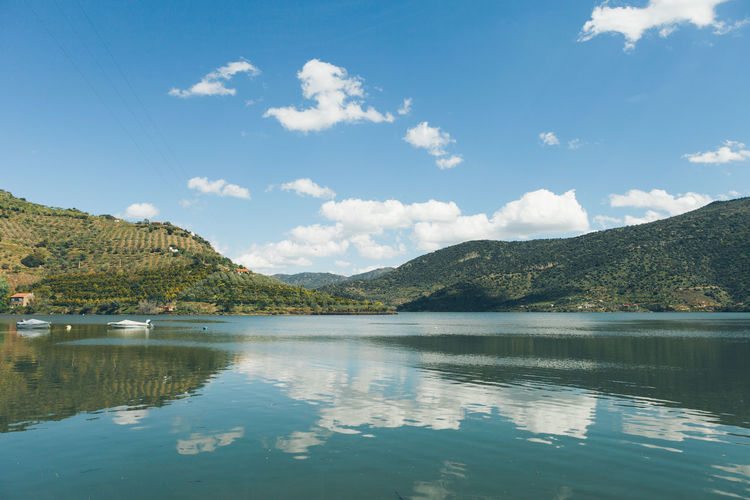 Beauty In Nature Blue Calm Cloud Cloud - Sky Countryside Day Idyllic Lake Majestic Mountain Mountain Peak Mountain Range Nature No People Non-urban Scene Outdoors Reflection Remote Scenics Sky Tranquil Scene Tranquility Water Waterfront