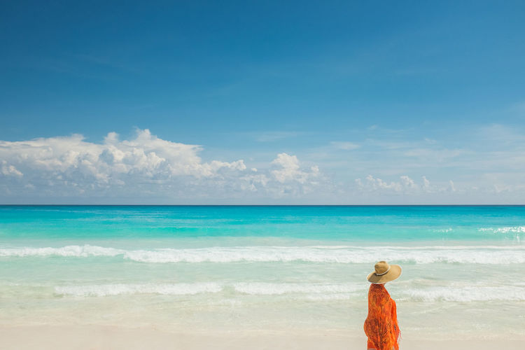 Woman walking by the beach in Cancun Beach Caribbean Contrasting Colors Travel Travelling Fujifilm X100T Travel Destinations Happiness Hollidays Joyful Moments Nature One Person One Woman Only Only Women Paradise Paradise Beach People Postcard Sand Sea Standing Tropical Climate Turquoise Vacations Vacations