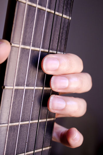 Acoustic Guitar Artist Arts Culture And Entertainment Close-up Finger Guitar Hand Holding Human Body Part Human Finger Human Hand Music Musical Equipment Musical Instrument Musical Instrument String Musician People Playing Plucking An Instrument String String Instrument