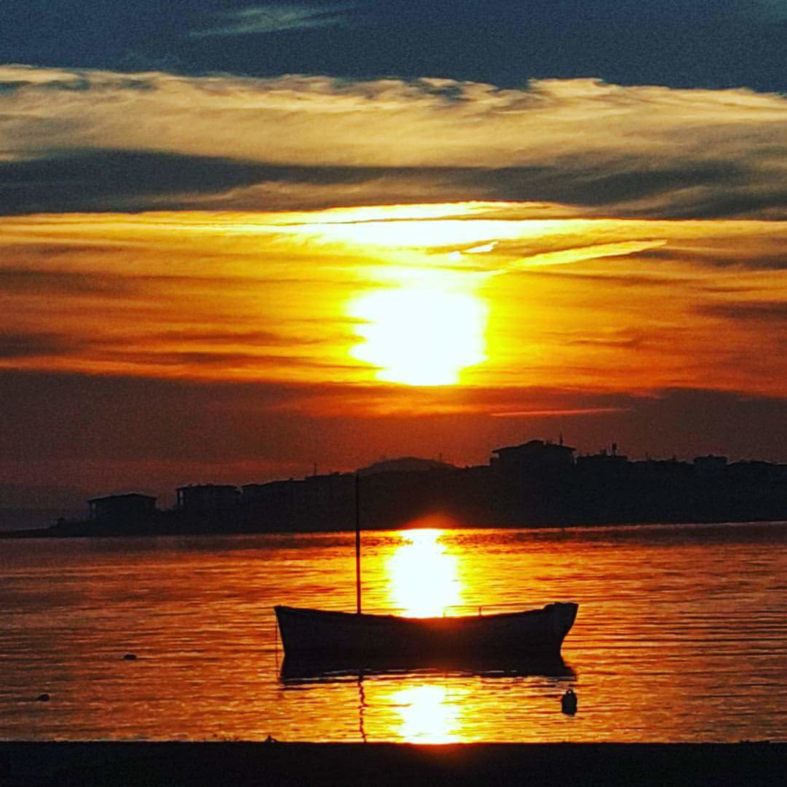sunset, orange color, sun, water, scenics, reflection, sky, beauty in nature, sea, tranquil scene, silhouette, tranquility, nautical vessel, sunlight, idyllic, nature, transportation, horizon over water, boat, cloud - sky