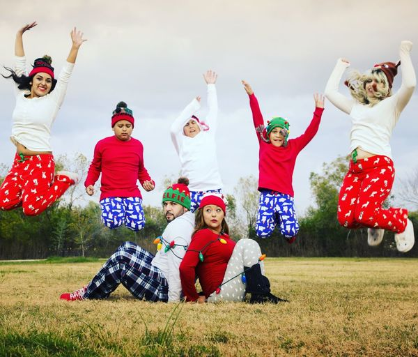 Funny Portrait Of Family In Christmas Clothing
