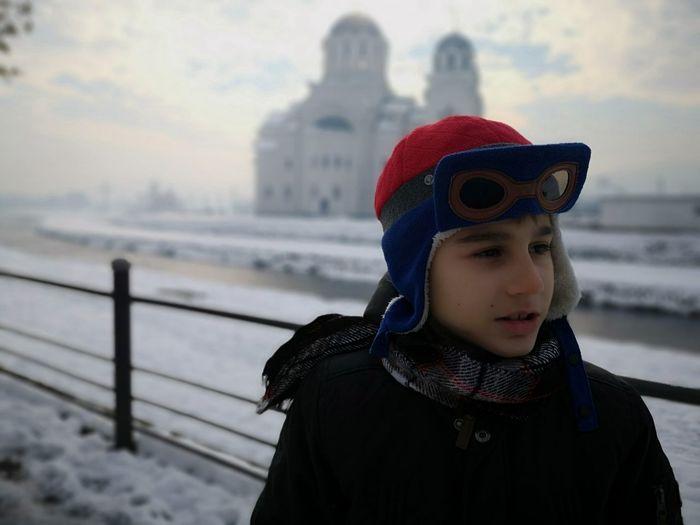 Boy wearing warm clothing during winter