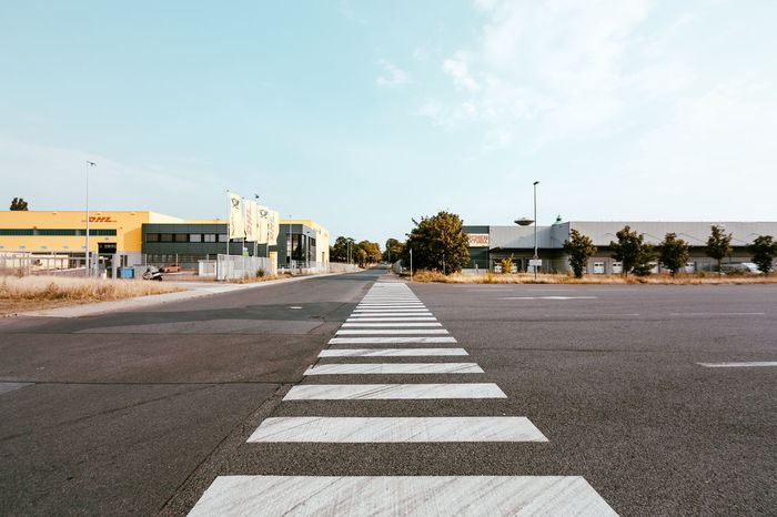 very long pedestrian crosswalk Architecture Blue Built Structure City City Life Cloud Cloud - Sky Crossing Day Diminishing Perspective Empty Long No People Outdoors Road Road Road Marking Sky Street Streetphotography The Way Forward Vanishing Point Walk Walk This Way Walkway