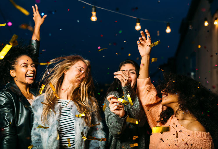 New Year Rooftop Terrace Arms Raised Carefree Celebration Cheerful Confetti Dancing Enjoyment Excitement Friendship Fun Happiness Illuminated Laughing Lifestyles Night Nightlife Party - Social Event Real People Smiling Togetherness Young Adult Young Women Be. Ready.