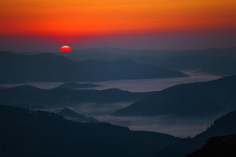 Incredible landscapes from Romania. Dark Morning Nature Red Blue First Light Fog Foggy Horizon Landscape Mountain Mountain Range Scenics Silhouette Sky Sun Sunrise Sunset Tranquil Scene Valley