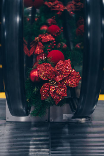 Close-up of red decoration by escalator