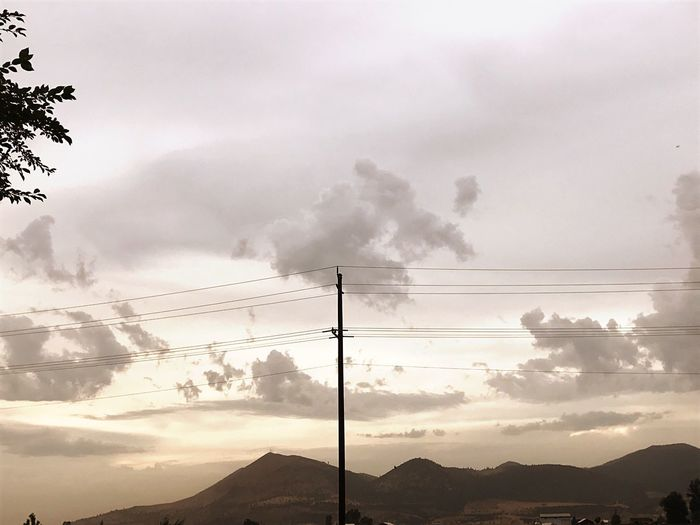 Cable Electricity  Electricity Pylon Fuel And Power Generation Power Supply Power Line  Mountain Connection Sky Technology No People Nature Silhouette Outdoors Cloud - Sky Low Angle View Beauty In Nature Scenics Mountain Range Day
