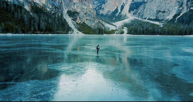 Miles Away One Person Adventure Nature Water Only Men Day Scenics Snow Tree Beauty In Nature Outdoors Men Real People Mountain Adults Only One Man Only Aquatic Sport Adult People Extreme Sports Icelake in South tyrol - pragser wildsee / Lago di braise