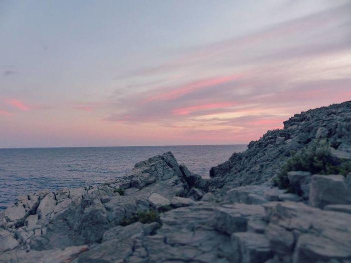 Oacean Sky Evening Sky Rocks And Water