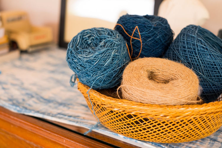 Art And Craft Ball Of Wool Basket Blue Close-up Container Craft Creativity Fishing Industry Focus On Foreground Indoors  Material No People Pattern Sewing Item Softness Still Life Table Textile Thread Wool