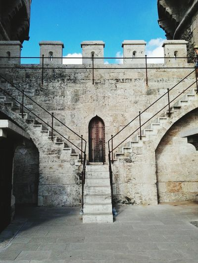 Architecture Built Structure Clear Sky Building Exterior Wall - Building Feature Blue Steps Staircase Railing Day Outdoors Arch Arched The Way Forward Stone Material No People History