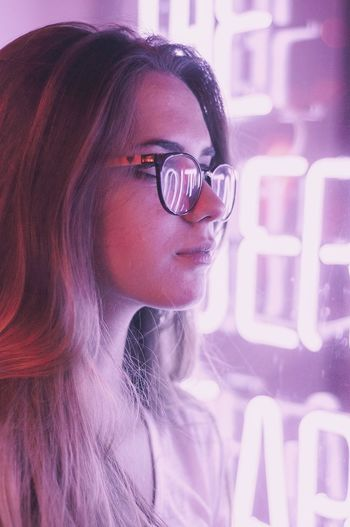 In the purple city Technology Women Futuristic Portrait One Person Innovation Computer Human Face Beauty Close-up One Woman Only Only Women Adults Only Adult Eyeglasses  People Internet Cyberspace Human Eye Big Data Lights Night Purple Outdoors Cityscape