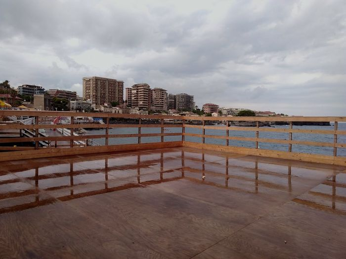 EyeEm Selects Day Beach Outdoors Sky No People Architecture Catania San Giovanni Li Cuti Stormy Weather Storm Cloud Waterfront Waterfront ViewSolarium Built Structure Raining Reflections In The Water Horizon Over Water EyeEmNewHere The Week On EyeEm