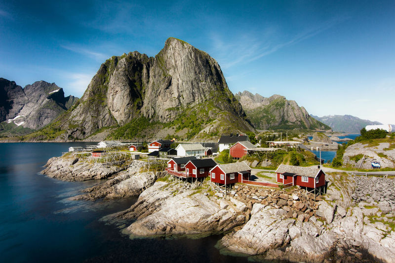 Hamnøy is one of the most beautiful villages on the Lofoten islands. It was taken on a sunny afternoon in the middle of July when the sun was just in the right position to illuminate the tiny little red houses from the front. E10 Hamnøya Lofoten Norway Lofoten Islands Northern Norway Norway Beauty In Nature Blue Clear Sky Day Lofoten Mountain Mountain Range Nature No People Outdoors Rock - Object Rorbuer Scenics Sea Sky Tranquil Scene Tranquility Water