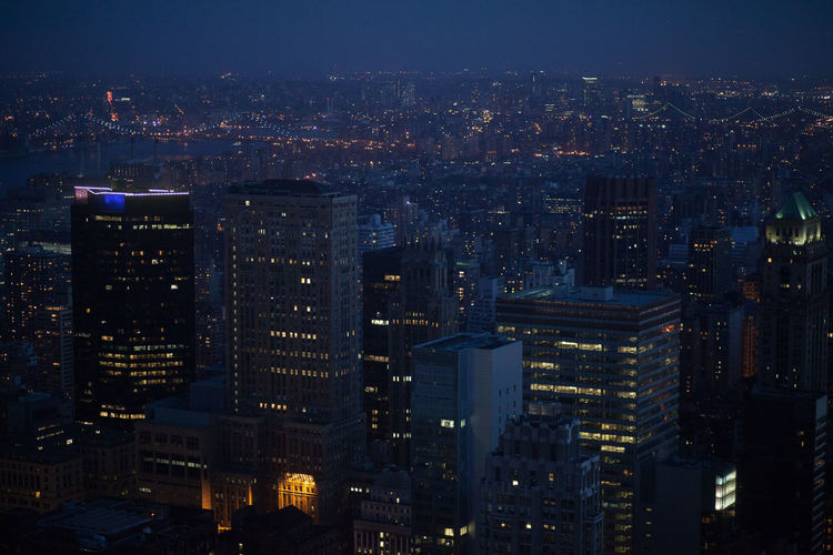 High Angle View of Buildings Lit Up At Night