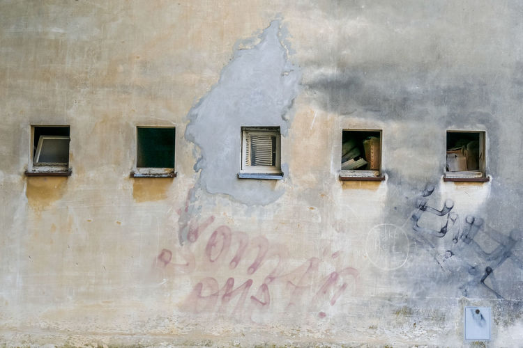 Built Structure Building Exterior Window Architecture Day No People Building Outdoors Wall - Building Feature Old Text Communication Weathered Nature Western Script City Residential District Metal Close-up Rusty