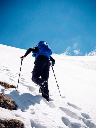 Low angle view of person skiing on snow