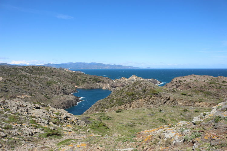 Scenic view of mountains and sea at cap de creus