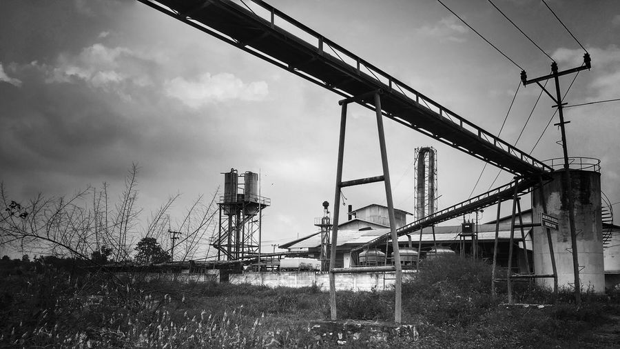Connection Architecture Built Structure Sky Day Rail Transportation Outdoors Low Angle View No People Bridge - Man Made Structure Building Exterior Factory Factory Building Black And White Tulung Buyut INDONESIA Flour Mill Tapioca