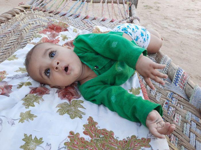 Portrait of cute baby lying down