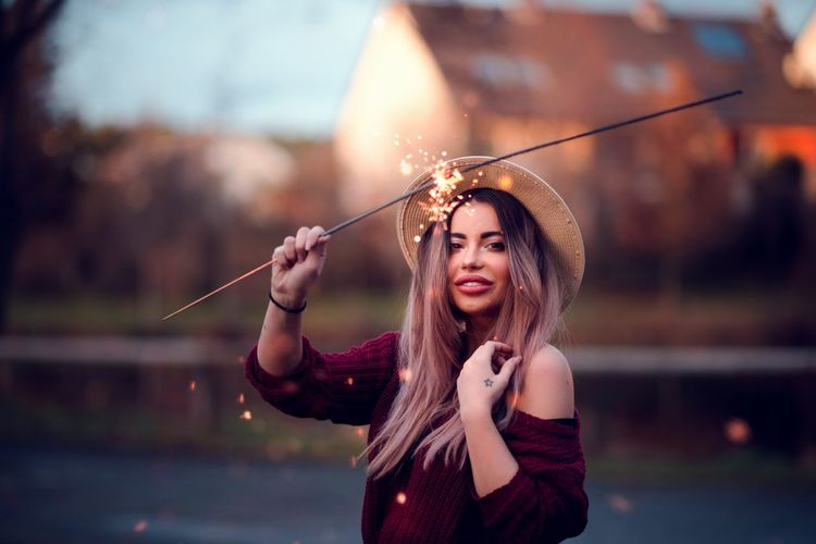 Portrait Of Beautiful Woman Holding Sparkler