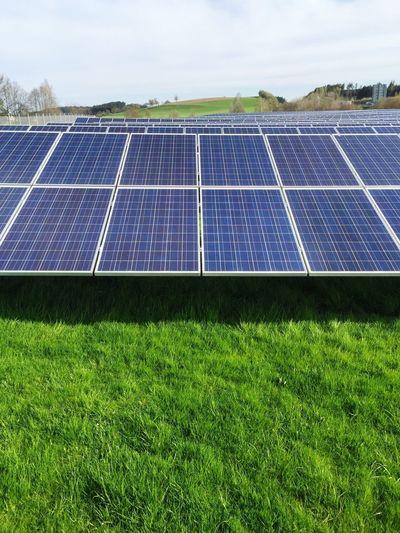 Solar panel on grassy field