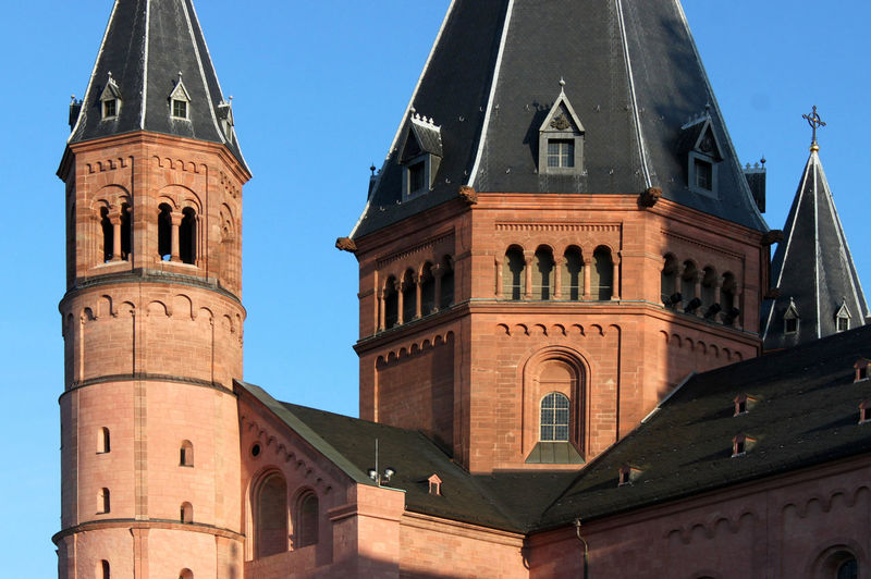 Close-up of red sandstone towers in the evening sun at Mainz cathedral Architectural Detail Architecture Basilica Building Exterior Cathedral Church Clear Sky Construction Detail Dome Germany History Intersection Mainz Medieval Monument No People Place Of Worship Red Religion Roman Romanesque Sandstone Spirituality Tower