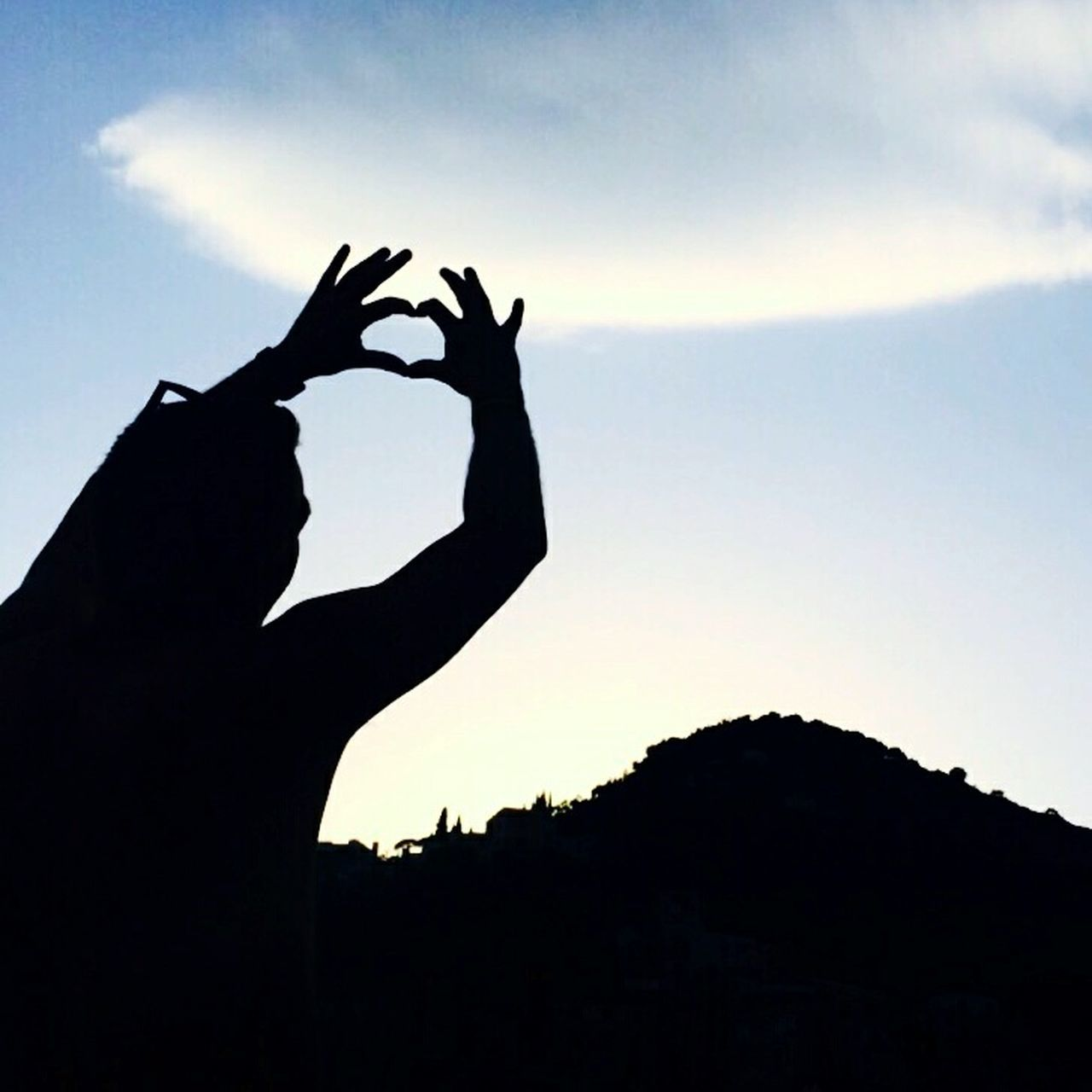 silhouette, human hand, sunset, sky, real people, gesturing, one person, human body part, nature, outdoors, beauty in nature, day, close-up, people