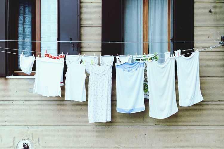 View Of Clothes Line Against Windows