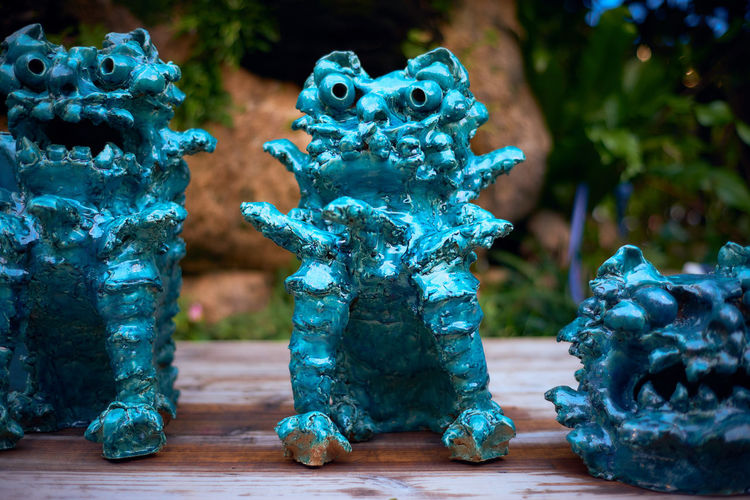 Turquoise statues on table