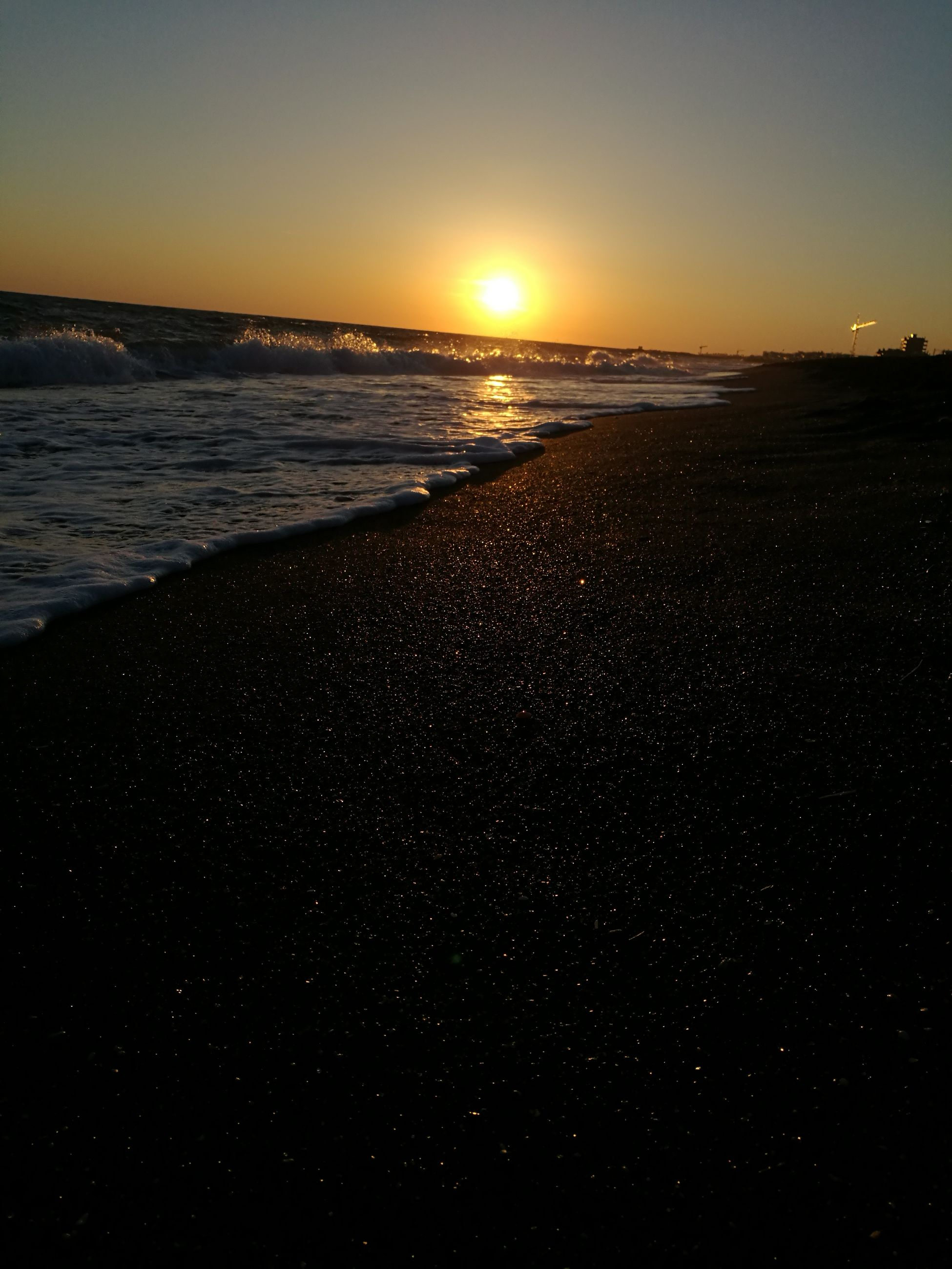 sunset, sea, nature, beauty in nature, beach, water, scenics, tranquility, tranquil scene, sky, sun, no people, outdoors, silhouette, wave, day