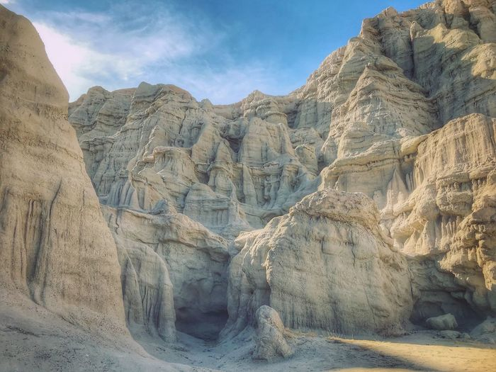 Large hoodoo formations Mountain Nature Rock - Object Day Landscape Beauty In Nature Tranquility No People Arid Climate Sky Scenics Outdoors Mountain Range Physical Geography