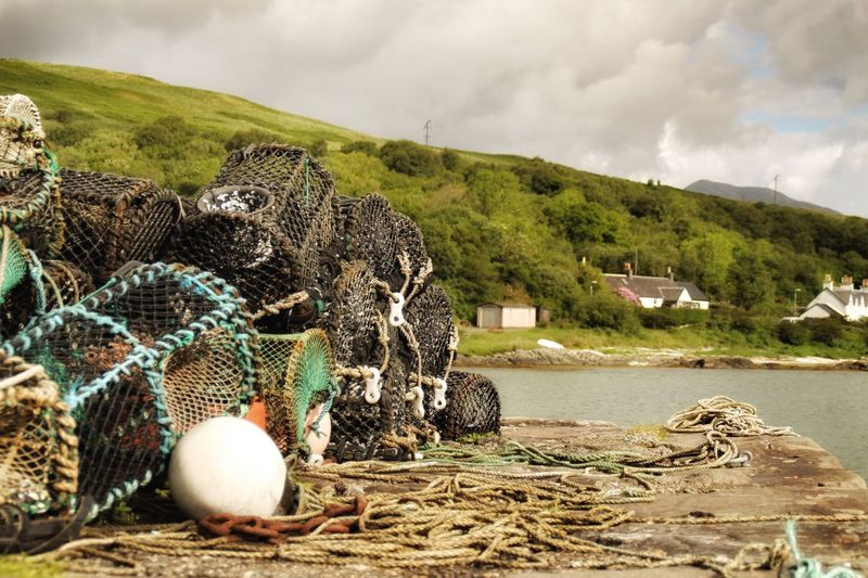 Fishing Net Buoy No People Day Rope Outdoors Mountain Nature Fishing Equipment Sky Beauty In Nature Nautical Vessel Water Moored Fishing Tackle Harbor Lobster Pots The Great Outdoors - 2017 EyeEm Awards