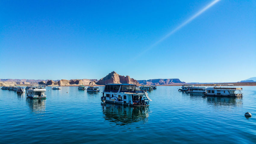 Lakepowell USAtrip Boats⛵️ Water Blue Clear Sky Waterfront Outdoors Nature Reflection Lake Amazing Place Human Creation In The Middle Of Dessert Boat Trip Goodvibes Wonderland Aroundtheworld Explore The World VSCO Vscophile Vsocam Happy Traveller First Eyeem Photo Amateurphotography Pictureoftheday EyeEmNewHere