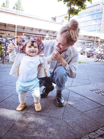 happy being with mom is learning to walk Motherhood Learning First Steps Sun Hat Baby Child Childhood Girls Females Offspring Togetherness Two People Family Women Full Length Emotion Happiness Cute Day Bonding Fun Positive Emotion