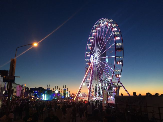 Arts Culture And Entertainment Night Amusement Park Amusement Park Ride Sky Illuminated Ferris Wheel Crowd Nature Leisure Activity Outdoors Lighting Equipment Enjoyment