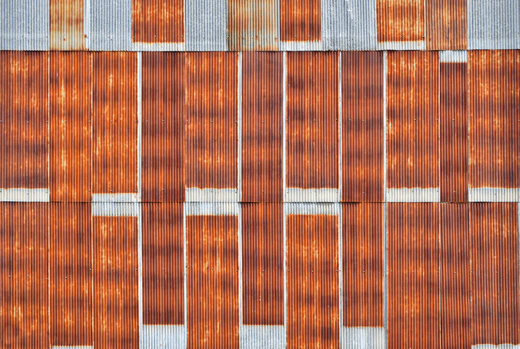 Full frame shot of rusty corrugated metallic wall