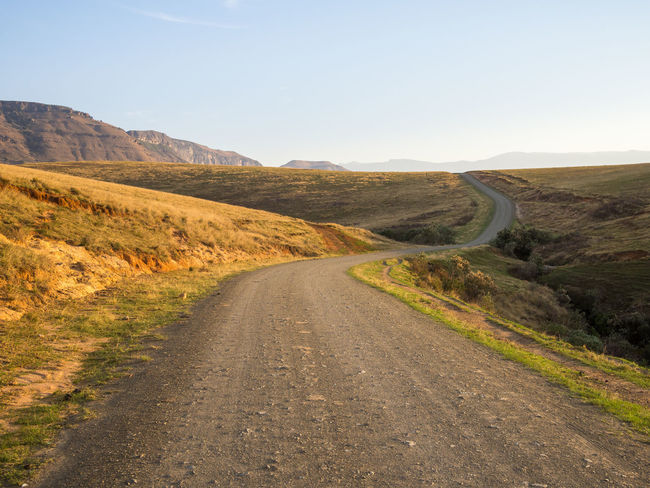 Drakensberg, South Africa Drakensburg Mountains, South Africa, Mountain Hiking Beauty In Nature Curve Day Drakensberg Grass Landscape Mountain Mountain Range Nature No People Outdoors Road Scenics Sky The Way Forward Tranquil Scene Tranquility Transportation Winding Road