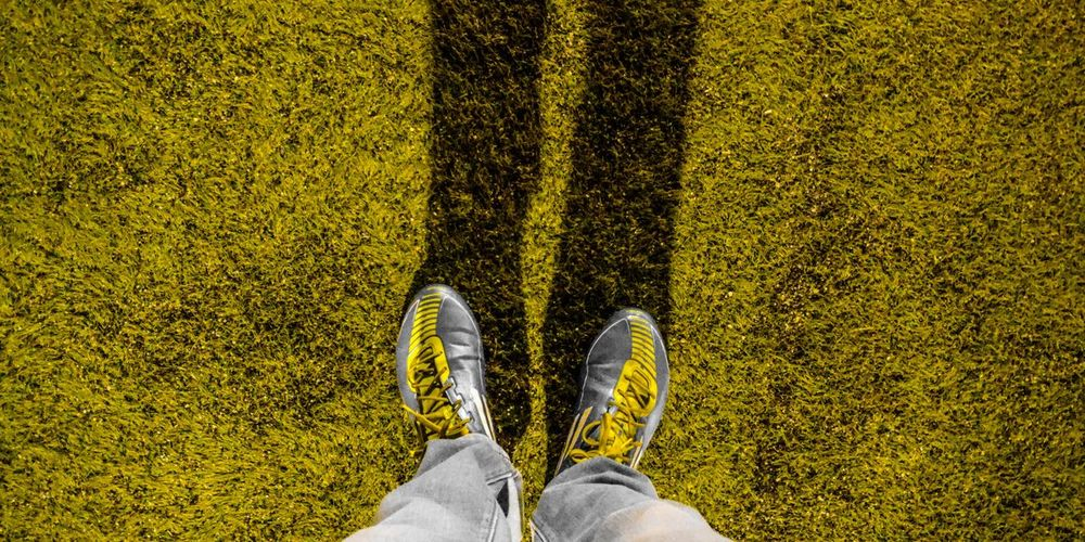 get ready for football game 🏈 Game Football Photos Soccer Field Match Low Section Men Standing Human Leg Shoe Yellow High Angle View Directly Above Personal Perspective Human Foot
