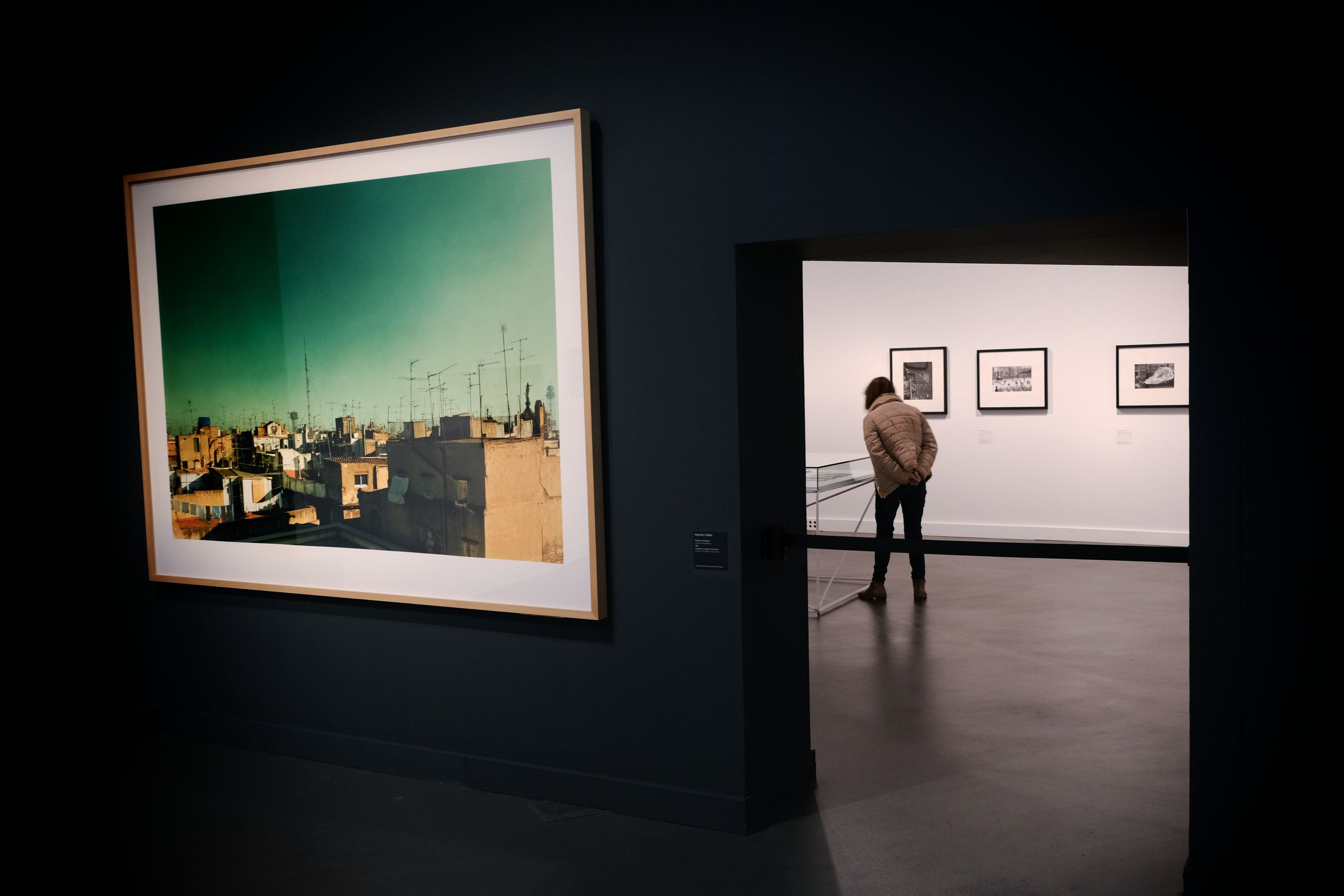indoors, one person, frame, lifestyles, real people, picture frame, museum, standing, home interior, architecture, domestic room, door, rear view, art museum, men, entrance, full length, leisure activity, exhibition