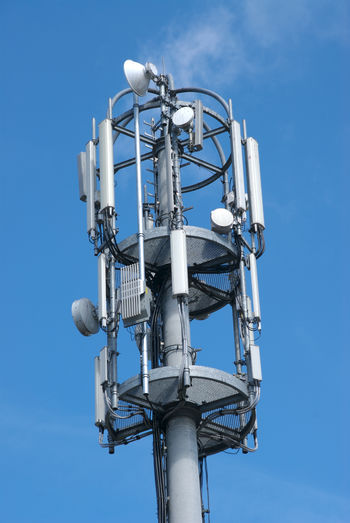 Low Angle View Of Cell Tower Against Blue Sky
