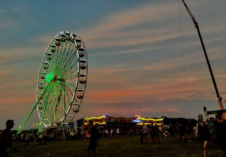 Arts Culture And Entertainment Leisure Activity Large Group Of People Real People Enjoyment Sky Fun Amusement Park Men Outdoors Cloud - Sky Women Lifestyles Day Nature People